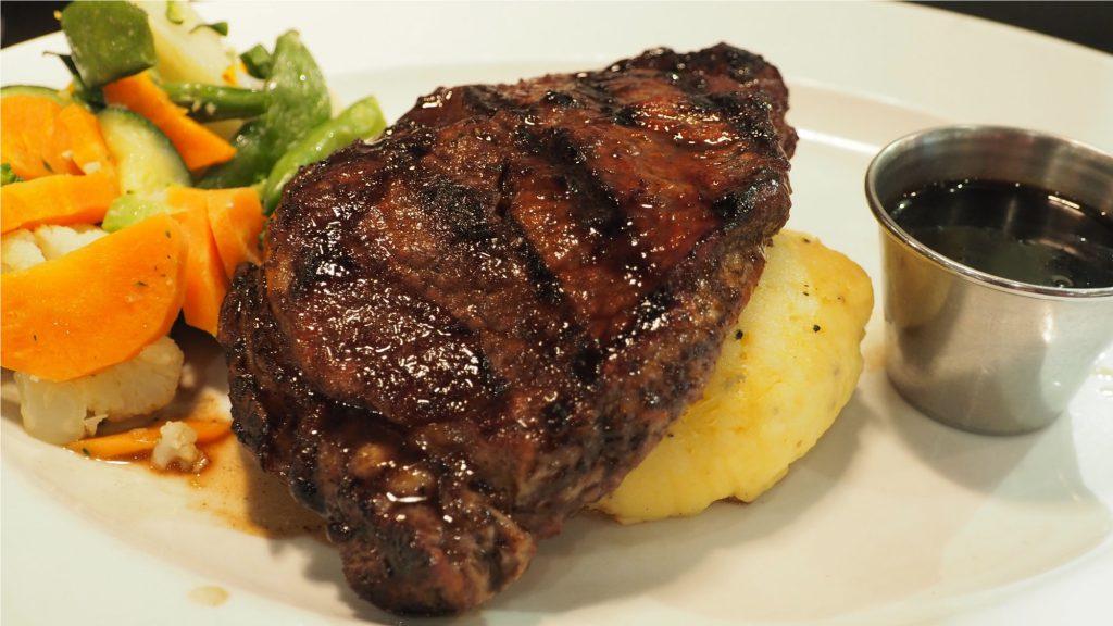 steak over potato and vegitables